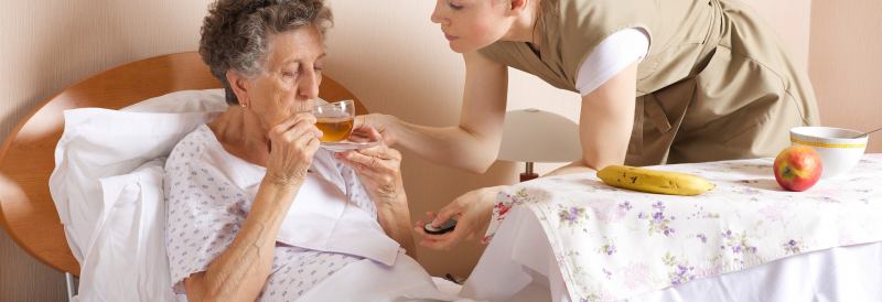 Senior being taken care of b a caregiver